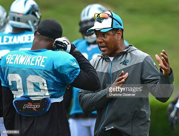Carolina Panthers cornerback Bene Benwikere receives instructions from defensive backs coach Steve Wilks during practice on Saturday Aug 2 at Gibbs...