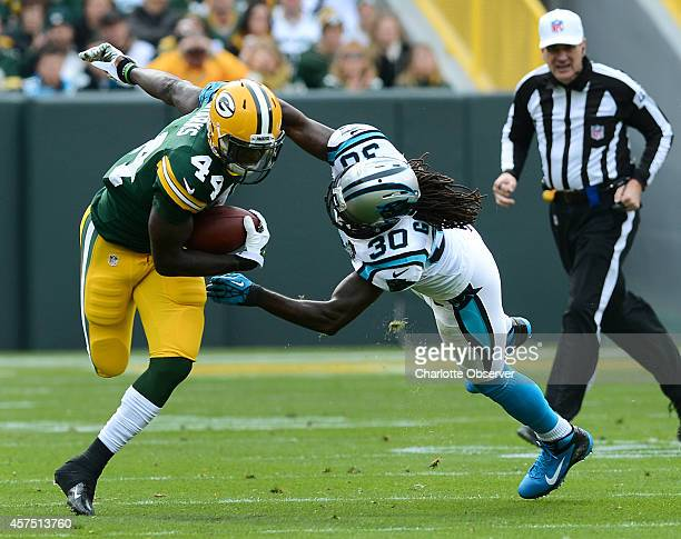 Carolina Panthers cornerback Charles Godfrey tries to make the tackle on Green Bay Packers running back James Starks during the first quarter on...