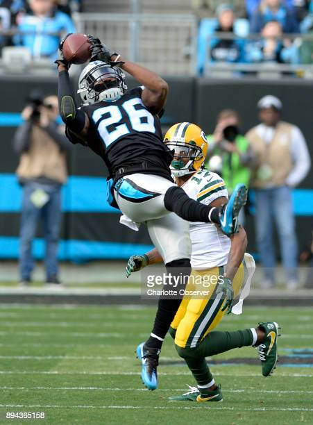 Carolina Panthers cornerback Daryl Worley intercepts an Aaron Rodgers pass intended for Green Bay Packers wide receiver Davante Adams on Sunday Dec...