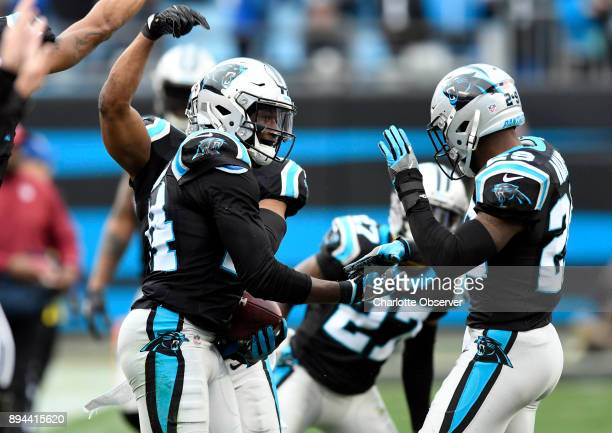 Carolina Panthers cornerback James Bradberry celebrates his interception against the Green Bay Packers with strong safety Mike Adams in the second...