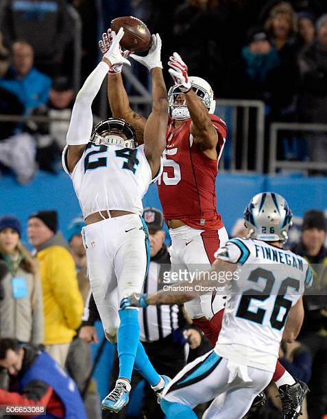 Carolina Panthers cornerback Josh Norman breaks up a pass into ended for Arizona Cardinals wide receiver Michael Floyd during the fourth quarter of...