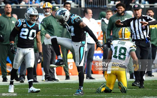 Carolina Panthers cornerback Kevon Seymour center celebrates his stop of Green Bay Packers wide receiver Randall Cobb's attempt at catching a pass...