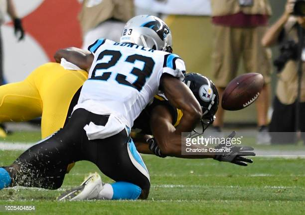Carolina Panthers cornerback LaDarius Gunter disrupts a pass intended for Pittsburgh Steelers wide receiver Trey Griffey during the first half of the...