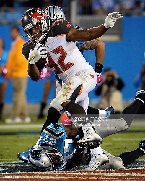 Carolina Panthers cornerback Robert McClain bottom left is unable to make the tackle on Tampa Bay Buccaneers running back Jacquizz Rodgers during...