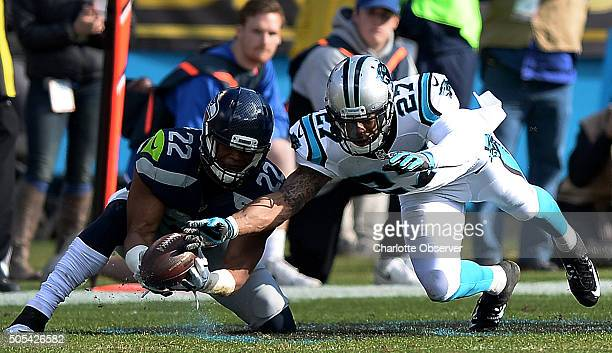 Carolina Panthers cornerback Robert McClain right prevents Seattle Seahawks running back Fred Jackson left from making a pass reception during the...
