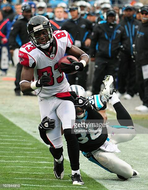 Carolina Panthers cornerback Robert McClain tries to make the tackle on Atlanta Falcons wide receiver Harry Douglas following a pass reception during...