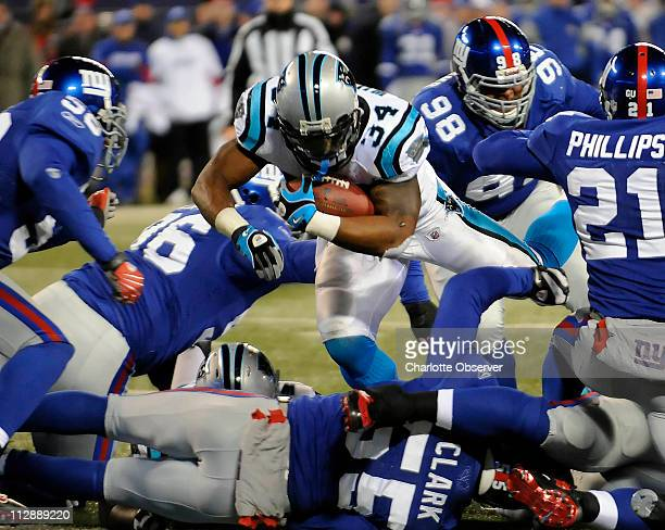 Carolina Panthers' DeAngelo Williams dives into the end zone through the New York Giants defense in the second quarter on Sunday December 21 at...