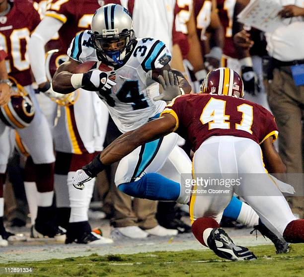 Carolina Panthers' DeAngelo Williams makes his way upfield toward Washington Redskins' Kareem Moore during the first quarter The Panthers faced the...
