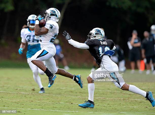 Carolina Panthers defensive back Robert McClain makes an interception as wide receiver Damiere Byrd reaches out during Carolina Panthers training...