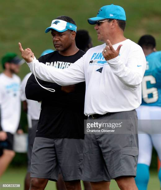 Carolina Panthers defensive coordinator Steve Wilks left and head coach Ron Rivera talk during training camp at Wofford College in Spartanburg SC on...