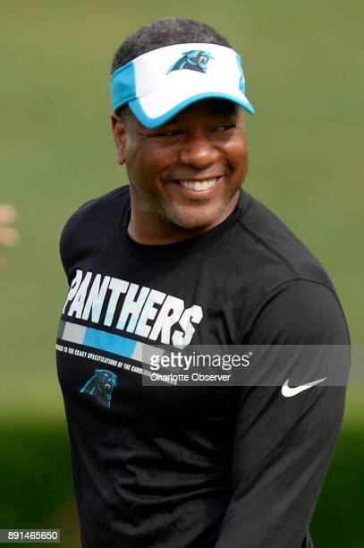 Carolina Panthers defensive coordinator Steve Wilks shares a smile during training camp at Wofford College in Spartanburg SC on August 12 2017