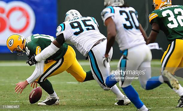 Carolina Panthers defensive end Charles Johnson chases down Green Bay Packers quarterback Aaron Rodgers to recover a loose ball during second quarter...