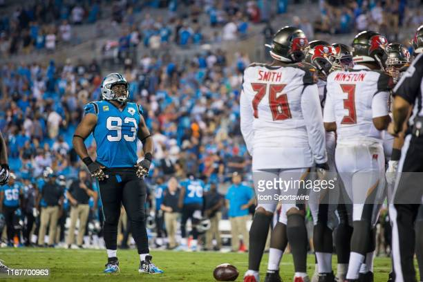 Carolina Panthers defensive end Gerald McCoy looks on at his former Tampa Bay Buccaneer teammates during a game between the Tampa Bay Buccaneers and...