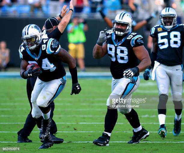 Carolina Panthers defensive end Kony Ealy left cradles the ball after intercepting a pass against the Arizona Cardinals on October 30 at Bank of...