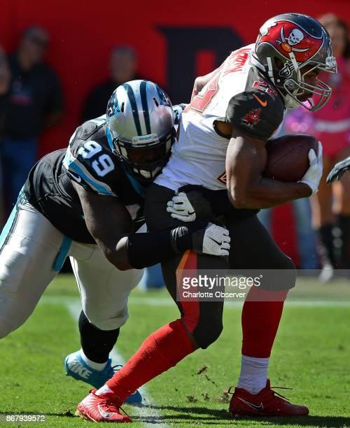 Carolina Panthers defensive tackle Kawann Short left makes the tackle on Tampa Bay Buccaneers running back Doug Martin right during third quarter...