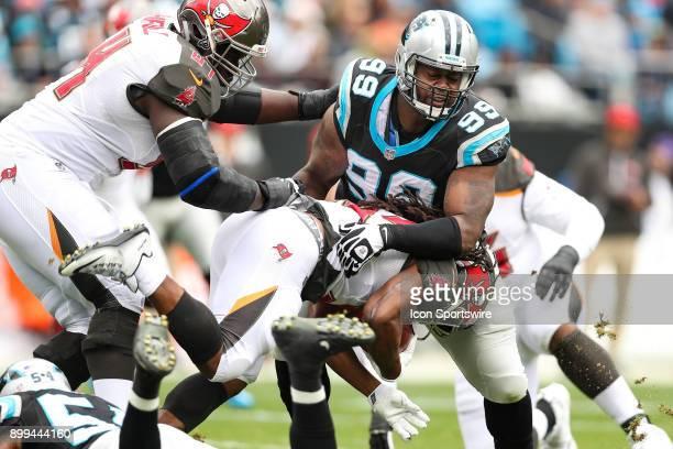 Carolina Panthers defensive tackle Kawann Short wraps up Tampa Bay Buccaneers running back Doug Martin during the first half between the Tampa Bay...