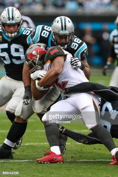 Carolina Panthers defensive tackle Star Lotulelei wraps up Tampa Bay Buccaneers running back Doug Martin during the first half between the Tampa Bay...