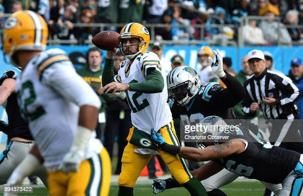 Carolina Panthers defensive tackle Vernon Butler center and defensive end Wes Horton right attempt to make the tackle on Green Bay Packers...