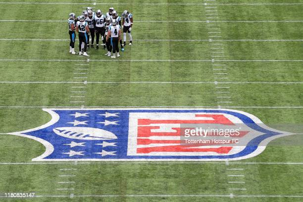 Carolina Panthers form a huddle during the NFL game between Carolina Panthers and Tampa Bay Buccaneers at Tottenham Hotspur Stadium on October 13...