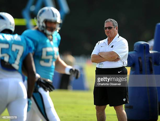 Carolina Panthers general manager Dave Gettleman right watches players run through drills during practice on Monday August 3 2015 in Spartanburg SC