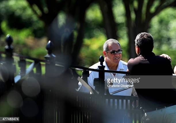Carolina Panthers general manager Dave Gettleman stops and talks with fans prior to the team's minicamp in Charlotte NC on Wednesday June 17 2015