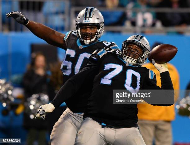 Carolina Panthers guard Trai Turner throws the football that running back Christian McCaffrey scored a touchdown with into the crowd as the team...