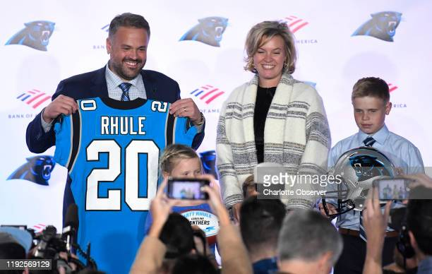 Carolina Panthers head coach Matt Rhule stands with his wife Julie and kids Vivi Leanna and Bryant far right after an introductory news conference at...