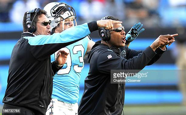 Carolina Panthers head coach Ron Rivera and Panthers secondary/passing defense coordinator Steve Wilks communicate with players while playing against...