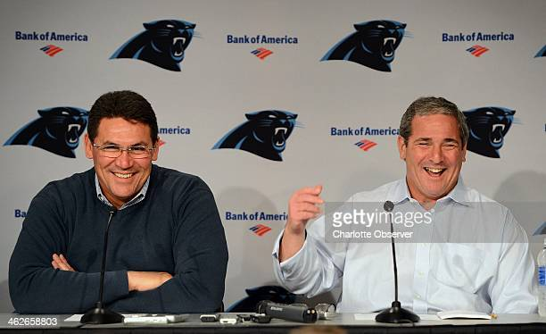 Carolina Panthers head coach Ron Rivera laughs with general manager Dave Gettleman while addressing questions from the media during a press...