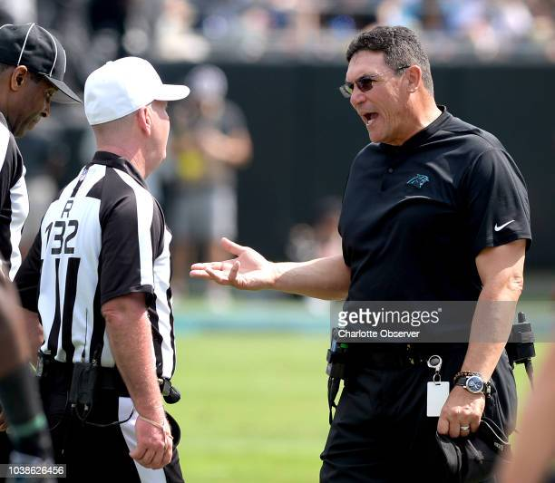 Carolina Panthers head coach Ron Rivera speaks with referee John Parry left during second quarter action against the Cincinnati Bengals on Sunday...