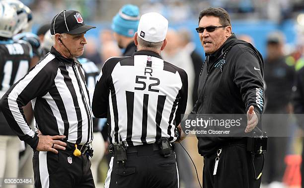 Carolina Panthers head coach Ron Rivera talks with referee Bill Vinovich during a break in the game against the Atlanta Falcons in the second half on...