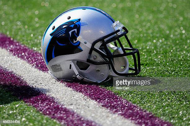 Carolina Panthers helmet sits on the turf before the start of the Panthers and Baltimore Ravens game at MT Bank Stadium on September 28 2014 in...