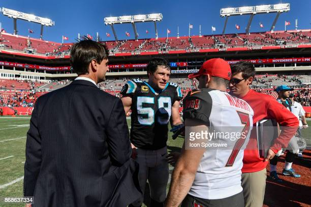 Carolina Panthers linebacker Luke Kuechly meets Tampa Bay Buccaneers kicker Patrick Murray after an NFL football game between the Carolina Panthers...
