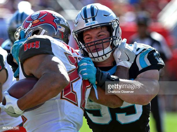 Carolina Panthers linebacker Luke Kuechly right makes the tackle on Tampa Bay Buccaneers running back Doug Martin left during fourth quarter action...