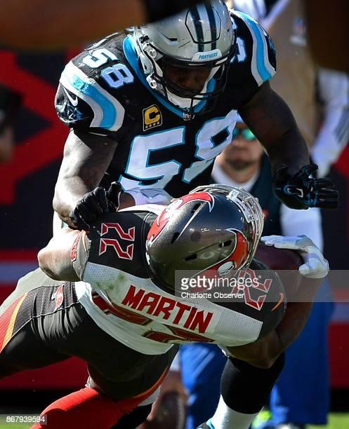 Carolina Panthers linebacker Thomas Davis makes a hard tackle on Tampa Bay Buccaneers running back Doug Martin during third quarter action on Sunday...
