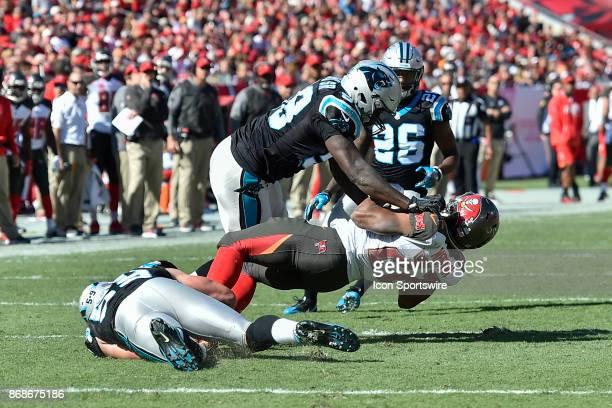 Carolina Panthers linebacker Thomas Davis tackles Tampa Bay Buccaneers running back Doug Martin during the second half of an NFL football game...