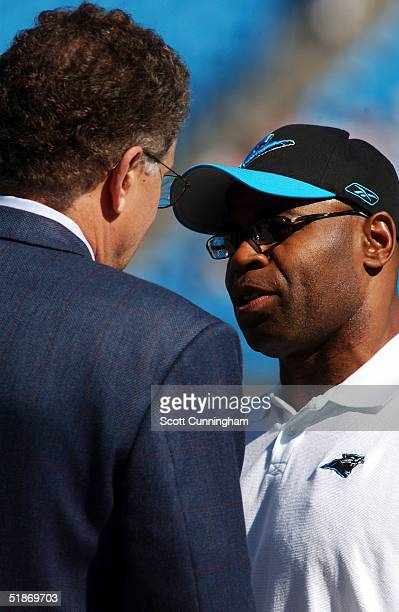 Carolina Panthers Linebackers Coach Sam Mills speaks with NFL Commissioner Paul Tagliabue before the game against the Tennessee Titans. The Titans...