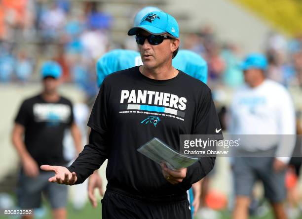 Carolina Panthers offensive coordinator Mike Shula talks to players during training camp at Wofford College in Spartanburg SC on Saturday Aug 12 2017