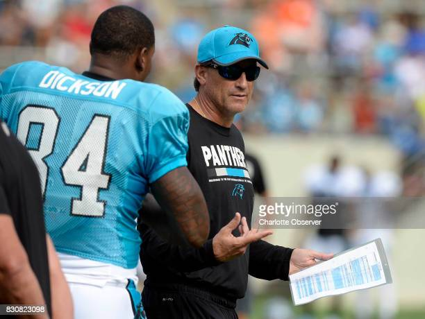 Carolina Panthers offensive coordinator Mike Shula talks with tight end Ed Dickson during training camp at Wofford College in Spartanburg SC on...