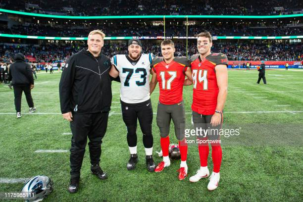 Carolina Panthers Offensive Guard Greg Van Roten poses with Tampa Bay Buccaneers Wide Receiver Justin Watson and Tampa Bay Buccaneers Tight End...