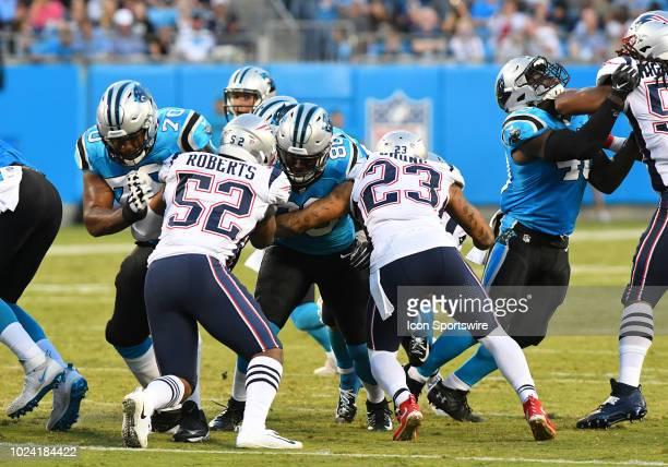 Carolina Panthers offensive guard Trai Turner and tight end Ian Thomas block for Carolina Panthers running back Christian McCaffrey on the run play...