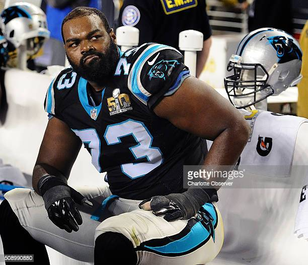 Carolina Panthers offensive tackle Michael Oher sits on the team's bench during the fourth quarter against the Denver Broncos in Super Bowl 50 at...