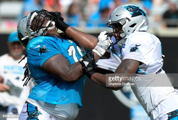 Carolina Panthers offensive tackle Tyrus Thompson left and defensive end Daeshon Hall block each other during a drill at training camp at Wofford...