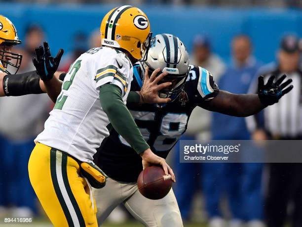 Carolina Panthers outside linebacker Thomas Davis pressures Green Bay Packers quarterback Aaron Rodgers during the second half on Sunday Dec 17 2017...