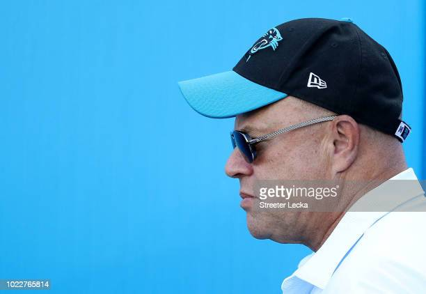 Carolina Panthers owner David Tepper walks the field before their game against the New England Patriots at Bank of America Stadium on August 24 2018...
