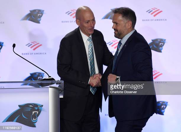 Carolina Panthers playbyplay announcer Mick Mixon left introduces new head coach Matt Rhule during an introductory news conference at Atrium Health...