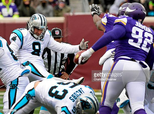 Carolina Panthers punter Brad Nortman has a second punt blocked by Minnesota Vikings linebacker Jasper Brinkley during second quarter action on...