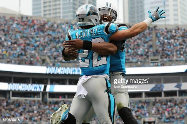 Carolina Panthers quarterback Cam Newton and Carolina Panthers running back Christian McCaffrey embrace to celebrate a touchdown during 1st half of...