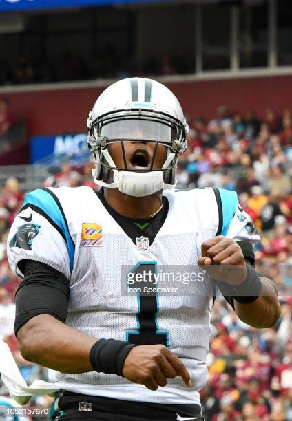 Carolina Panthers quarterback Cam Newton celebrates a fourth quarter touchdown against the Washington Redskins on October 14 at FedEx Field in...
