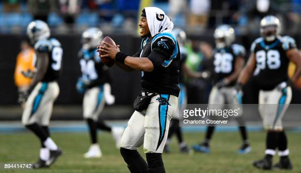 Carolina Panthers quarterback Cam Newton celebrates with the ball after the defense recovered a fumble against the Green Bay Packers late in the game...